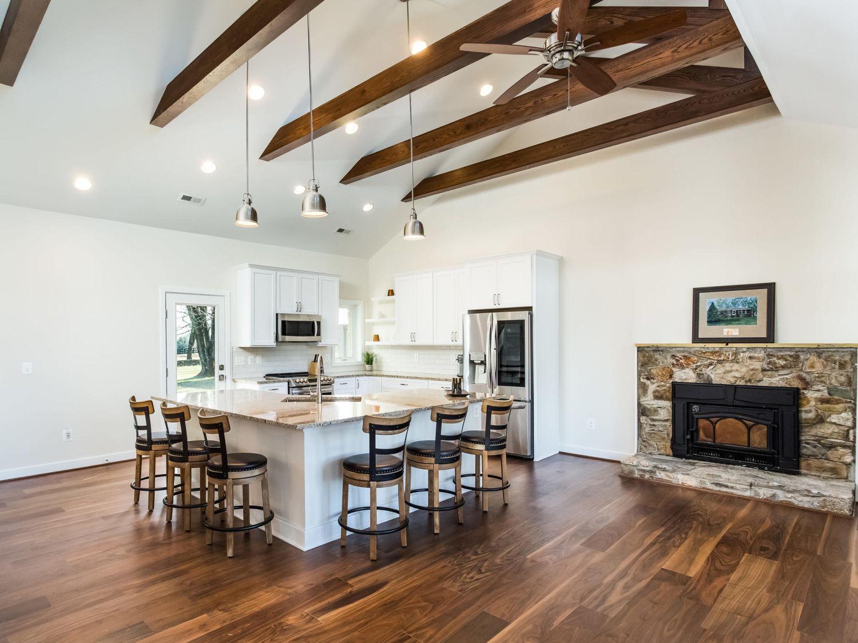 Bluemont interior remodel kitchen ceiling beams fireplace hardwood floors